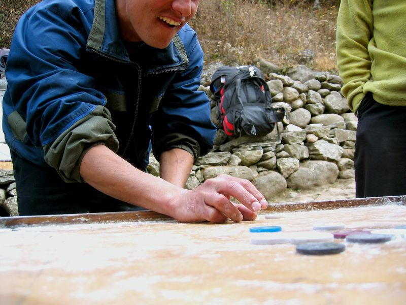 National game of Nepal: caranboard. Think pool with tiddlywinks.