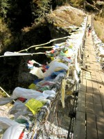 Prayer flags on one of a dozen or so suspension bridges along the trail.