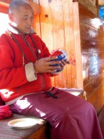 Monk in Tengboche blessing Mark's prayer flags.