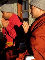 More monks to bless Mark's paragliding gear. If you were jumping off 18,000 ft. peaks you'd have everything blessed too.